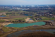 Nederland, Limburg, gemeente Stein, 07-03-2010; Meers, met Julianakanaal en DSM Chemelot in Geleen aan de horizon. In de voorgrond werkzaamheden in het kader van het project Grensmaas, de gegraven plas gaat dienen als gronddepot.  .Grensmaas project is een samenspel van rivierbeveiliging door stroomgeulverbreding en oeververlaging, natuurontwikkeling en ontgrinding..Meers, with Julianakanaal and DSM Chemelot in Geleen in the distance. In the foreground activities under the project Meuse, dug the lake will become the depot grounds. Grensmaas (Border Meuse) project is a combination of security by stream channel widening and bank reduction, habitat developemnet and 'de-gravelisation').luchtfoto (toeslag), aerial photo (additional fee required).foto/photo Siebe Swart