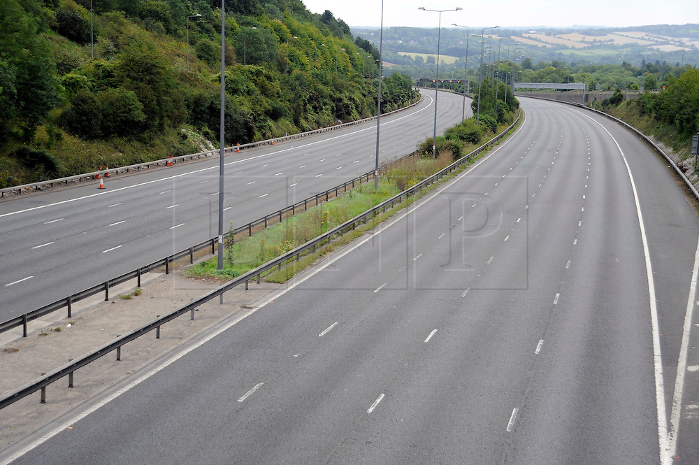 © Licensed to London News Pictures. 06/08/2011 Reigate, UK. An empty section of the M25  near junctions 7 and 8 today (06/08/2011) following a serious crash yesterday. Motorists endured a 28-mile tailback on the motorway yesterday after a crash  in which a lorry went through the central reservation and hit a car shut both carriageways. Photo credit : Grant Falvey/LNP