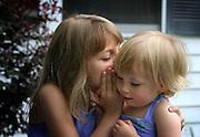 Sisters share a secret.