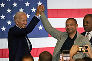 Former Vice President Joe Biden is welcomed by South Carolina State Senator Marlon Kimpson for a town hall meeting at the International Longshoreman's Association Hall July 7, 2019 in Charleston, South Carolina.
