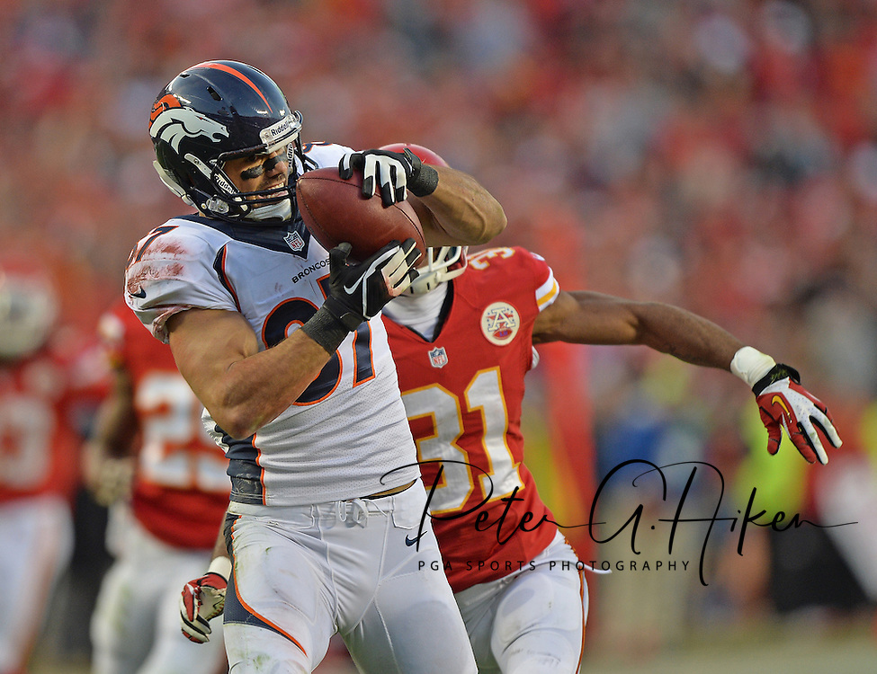 KANSAS CITY, MO - DECEMBER 01:  Wide receiver Eric Decker #87 of the Denver Broncos catches a pass against defensive back Marcus Cooper #31 of the Kansas City Chiefs during the first half on December 1, 2013 at Arrowhead Stadium in Kansas City, Missouri.  (Photo by Peter Aiken/Getty Images) *** Local Caption *** Eric Decker;Marcus Cooper