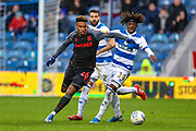 Stoke City forward Tyrese Campbell (26) tussles with Queens Park Rangers midfielder Eberechi Eze (10) during the EFL Sky Bet Championship match between Queens Park Rangers and Stoke City at the Kiyan Prince Foundation Stadium, London, England on 15 February 2020.