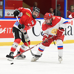 WHITBY, - Dec 15, 2015 -  WJAC Game 6- Team Russia vs Team Switzerland at the 2015 World Junior A Challenge at the Iroquois Park Recreation Complex, ON. Nikita Gromov #4 of Team Russia battles for the puck with Andre' Heim #26 of Team Switzerland during the first period.<br /> (Photo: Andy Corneau / OJHL Images)
