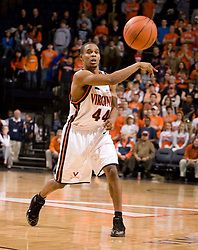 Virginia guard Sean Singletary (44) passes the ball in action against NCSU.  The Virginia Cavaliers men's basketball team defeated the North Carolina State Wolfpack 78-60 at the John Paul Jones Arena in Charlottesville, VA on February 24, 2008.