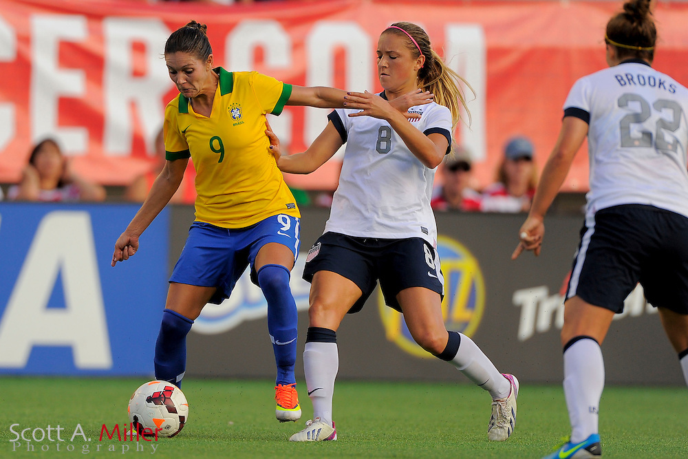 Brazil forward Gabi (9) and U.S. defender Kristie Mewis (8) fight for the ball during an international friendly at the Florida Citrus Bowl on Nov. 10, 2013 in Orlando, Florida. The U.S. won 4-1.<br /> <br /> <br /> &copy;2013 Scott A. Miller