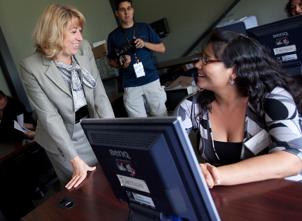 August 31, 2010--  <br /> Minister Broten speaks with Jillian Fraser at an WIST announcement at the Ogwehoweh Skills and Trades Training Centre August 31, 2010.<br /> (GEOFF ROBINS/ HO/ )