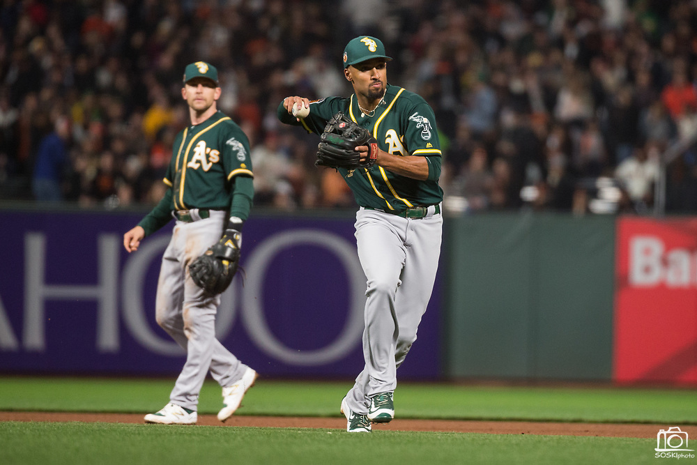 Oakland Athletics shortstop Marcus Semien (10) chases down a ground ball against the San Francisco Giants at AT&T Park in San Francisco, California, on March 30, 2017. (Stan Olszewski/Special to S.F. Examiner)