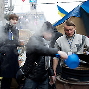 December 19, 2013 - Kiev, Ukraine: Pro-EU demonstrators prepare food for free distribution at  the Independence Square.<br /> On the night of 21 November 2013, a wave of demonstrations and civil unrest began in Ukraine, when spontaneous protests erupted in the capital of Kiev as a response to the government&rsquo;s suspension of the preparations for signing an association and free trade agreement with the European Union. Anti-government protesters occupied Independence Square, also known as Maidan, demanding the resignation of President Viktor Yanukovych and accusing him of refusing the planned trade and political pact with the EU in favor of closer ties with Russia.<br /> After a days of demonstrations, an increasing number of people joined the protests. As a responses to a police crackdown on November 30, half a million people took the square. The protests are ongoing despite a heavy police presence in the city, regular sub-zero temperatures, and snow. (Paulo Nunes dos Santos/Polaris)
