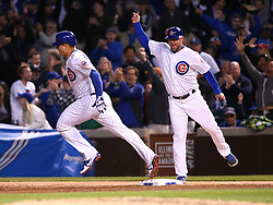 June 6, 2017 - Chicago, IL, USA - Chicago Cubs first base coach Brandon Hyde celebrates as Anthony Rizzo, left, rounds the bases after a three-run home run in the fifth inning against the Miami Marlins at Wrigley Field in Chicago on Tuesday, June 6, 2017. (Credit Image: © Chris Sweda/TNS via ZUMA Wire)
