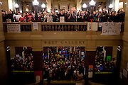 Protestors chant as Republican representatives manuever to quickly pass a bill to eliminate collective bargaining at the State Capitol in Madison, Wisconsin, February 24, 2011.