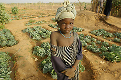 Fatima stands in a garden that Oxfam supported in the village of Intedeyne March 14, 2007. In this arid landscape, it requires a lot of work to maintain any kind of agriculture but it is one of the projects along with  education that Oxfam is supporting here.  Mali has the highest percentage of people living below the poverty line in any country in the world. Ninety percent of Malians survive on less than two dollars a day. In 2000, following the international commitments on education, the Government of Mali created a ten year education development program and as a result, donars provided two and a half times more aid to basic education. As a result, more than 6 out of 10 primary school age children are now enrolled in Mali. Yet the challenge to educate still exists and particularly for girls. Female literacy rates never reach even 50 percent of male literacy rates.Eight of the world's ten countries farthest from the gender parity goal are in West Africa: Niger, Chad, Burkina Faso, Mali, Ivory Coast, Guinea-Bissau, Benin and Guinea.