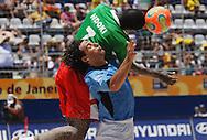 Football-FIFA Beach Soccer World Cup 2006 - Group C-CAM_URU - Ndoki-CAM- head the ball in front of Damian-URU - Rio de Janeiro - Brazil 06/11/2006<br />Mandatory credit: FIFA/ Marco Antonio Rezende.