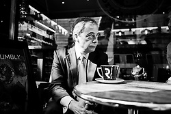 Ukip Leader Nigel Farage having a coffee and a cigarette in Westminster, London, United Kingdom. Thursday, 29th August 2013. Picture by Andrew Parsons / i-Images