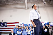 GOP presidential candidate Gov. Mitt Romney takes the stage at a campaign rally at EIT LLC, and electronics design and manufacturing company, in Sterling, Virginia, June 27, 2012.