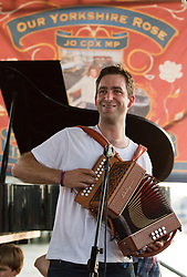 © Licensed to London News Pictures. 18/06/2017. LONDON, UK.  Brendan Cox, husband of murdered MP, Jo Cox plays in his folk band, the Diddly Dee at The Great Get Together at Tower Bridge Moorings in London last night, 17th June 2017. Friends and residents from Hermitage Moornings, where Jo Cox lived on a houseboat with her husband and two children visited residents and friends at nearby Tower Bridge moorings on the River Thames. Photo credit: Vickie Flores/LNP