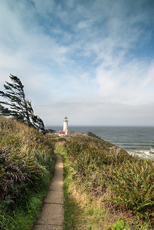 North Head Light, Washington <br /> <br /> Whether named by a British sea captain who turned back before finding the Columbia (1788) or a Lewis &amp; Clark Expedition member who was abject at finding no ships at the end of the cross country trek (1805), Cape Disappointment is also infamous for being on a list of the 10 most depressing places in the country.  But even these places can have a good day, and I got one while travelling the coast of Oregon and Washington.  The North Head Light was built to enhance navigation, and sits on a dramatic cliff over treacherous water.  Windblown, narrow trails hug the headlands, high above the Pacific. While exploring these and avoiding the people at the light, I found composition around a little hillock above the light house pad, and waited for a lull in the breeze.  Despite the disreputable name of this area, lights rarely let you down, most being hosted by rugged real estate in spectacular locations, and North Head was no disappointment.