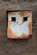 Resembling a punched face is a rusting cigarette receptacle in a Northumbrian town, on 26th September 2017, in Alnwick, Northumberland, England.