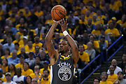 April 30, 2019; Oakland, CA, USA; Golden State Warriors forward Alfonzo McKinnie (28) shoots the basketball against the Houston Rockets during the third quarter in game two of the second round of the 2019 NBA Playoffs at Oracle Arena. The Warriors defeated the Rockets 115-109.