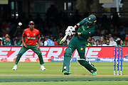 Imad Wasim of Pakistan hits the ball over the boundary for six runs during the ICC Cricket World Cup 2019 match between Pakistan and Bangladesh at Lord's Cricket Ground, St John's Wood, United Kingdom on 5 July 2019.