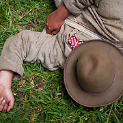 A confederate reenactor rests prior to the reenactment of Pickett's Charge, during the Sesquicentennial Anniversary of the Battle of Gettysburg, Pennsylvania on Sunday, June 30, 2013.  A pivotal battle in the Civil War, over 50,000 soldiers died in the battle which spanned 3 days from July 1-3, 1863.  Later that year, President Abraham Lincoln returned to Gettysburg to deliver his now famous Gettysburg Address to dedicate the cemetery there for the Union soldiers who died in battle.  John Boal photography