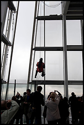 Members of the public take pictures of maintenance workers absailing down the Shard  as the London Mayor Boris Johnson officially opens the Shard building to the General public, central London, Friday February 1, 2013. Photo By Andrew Parsons / i-Images