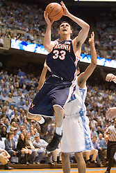 Virginia's Jason Cain (33) leaps towards the basket against UNC.  The #1 ranked Tar Heels beat the Cavaliers 79-69 to improved to 15-1 overall, 2-0 ACC on January 10, 2007 at the Dean Smith Center in Chapel Hill, NC...<br />