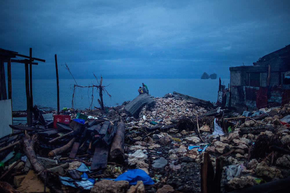 Residents of Beachfront community in Samar gather after sunset.