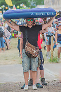 Inflatable beds are carried back to tents - The 2017 Glastonbury Festival, Worthy Farm. Glastonbury, 2 June 2017
