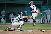 Grand Island U-Save catcher Chase Kiser tags out Holdrege runner Jacob Fuehrer at home plate after getting the throw from left fielder Tyler Zebert during the second inning of Friday's game against Holdrege at Ryder Park in Grand Island. (Independent/Matt Dixon)