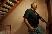 Policeman form BAC unit during police raid in the poor neighborhood Font Vert (Marseille). Font Vert is one of the poorest districts in the city, used as a basis for drug trafficking on a large scale. In North Marseille, drug traffic is flourishing, leading to murders among groups of competing dealers. 19 people were shot dead in drugs related killings in 2012, mainly with Kalachnikovs....Policier du BAC armé descend a tout allure d'une voiture banalisé et se lance à la poursuite d'un dealer au début d'une descente de la police dans le quartier pauvre Font Vert (Marseille)..Font Vert est une des cités les plus pauvres dans la ville, utilisée comme une base pour le trafic de drogue à grande échelle. Dans les quartiers du Nord le  trafic de drogue est florissante, conduisant à des reglements de compte par des groupes de dealers concurrents.......Patrick, major in de BAC-eenheid klopt op een deur tijdens een politieinval in de arme wijk Font Vert (Marseille). De politie zoekt een dealer die ergens een appartement is binnengevlucht. .Font Vert is één van de armste flatwijken in de stad, en wordt gebruikt als basis voor grootschalige drugshandel. Er vonden onlangs afrekeningen in het drugsmilieu in Font Vert plaats.