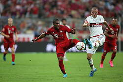 04.08.2015, Allianz Arena, Muenchen, GER, AUDI CUP, FC Bayern Muenchen vs AC Mailand, im Bild Douglas Costa (FC Bayern Muenchen #11) im Zweikampf gegen Luca Antonelli (AC Mailand #31) // during the 2015 Audi Cup Match between FC Bayern Muenchen and AC Mailand at the Allianz Arena in Muenchen, Germany on 2015/08/04. EXPA Pictures © 2015, PhotoCredit: EXPA/ Eibner-Pressefoto/ Schüler<br /> <br /> *****ATTENTION - OUT of GER*****