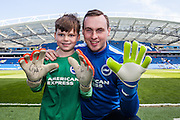 Young Albion fan Harry Dean celebrates his 8th birthday by meeting his hero Brighton goalkeeper David Stockdale before the Sky Bet Championship match between Brighton and Hove Albion and Burnley at the American Express Community Stadium, Brighton and Hove, England on 2 April 2016. Photo by Bennett Dean.