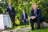 Three business leaders from the Copenhagen-based firm DEAS are pictured during an official group portrait sitting