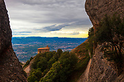 View from Ermita de Sant Joan, from the cliffhanging Ermita de Sant Onofre, Montserrat, Catalonia, built in the 19th Century next the Ermita de Sant Onofre, which is built into the cliff above in the Tebes area, near the Sant Joan funicular.
