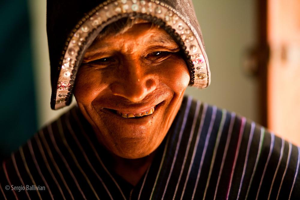 Portrait of a Quechua man in traditional attire in Tarabuco, Chuquisaca, Bolivia.