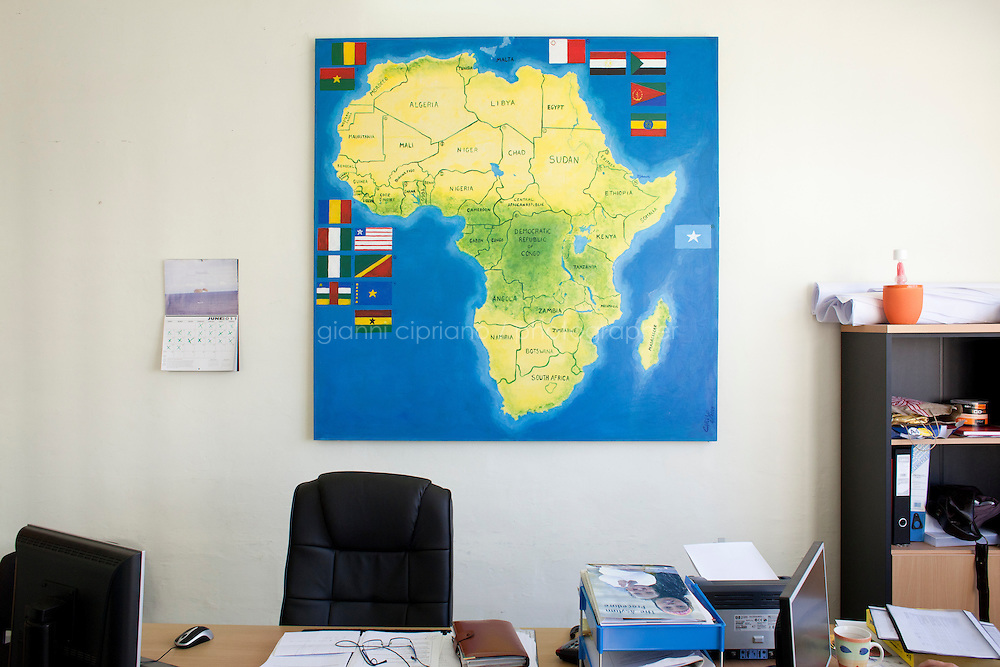 MARSA, MALTA - JUNE 20: A map of Africa is here in one of the offices of the Marsa Open Centre in Marsa on June 20, 2011. The Marsa Open Centre's capacity is of 650 people, but now hosts 900 immigrants, most of which are from Somalia. The centre's popoulation is composed of immigrants who received subsidary protection, asylum seekers (immigrants who applied and wait for their case to be handled), and rejected asylum seekers. The Open Centres in Malta serve as a temporary accomodation facility, but they ended becoming permanent accomodation centres. All immigrants who enter in Malta illegally are detained. Upon arrival to Malta, irregular migrants and asylum seekers are sent to one of three dedicated immigration detention facilities. Once apprehended by the authorities, immigrants remain in detention even after they apply for refugee status. detention lasts as long as it takes for asylum claims to be determined. This usually takes months; asylum seekers often wait five to 10 months for their first interview with the Refugee Commissioner. Asylum seekers may be detained for up to 12 months: at this point, if their claim is still pending, they are released and transferred to an Open Center.