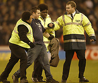 Photo: Aidan Ellis.<br /> Sheffield United v Manchester City. The Barclays Premiership. 26/12/2006.<br /> An unwanted City fan is escorted of the pitch aftyer running on after his team scored