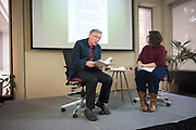 John Greening, editor of Edmund Blunden's WWI memoir, &quot;Undertones of War&quot;, is interviewed by Ohio University associate professor Nicole Reynolds during an Authors at Alden event in Alden Library on Nov. 8, 2018.<br /> Photo by Hannah Ruhoff