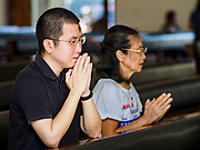 06 MARCH 2019 - BANGKOK, THAILAND: People pray the rosary after being annointed with ashes at Holy Redeemer Catholic Church in Bangkok on Ash Wednesday. There are about 300,000 Catholics in Thailand in about 430 Catholic parishes and about 660 Catholic priests in Thailand. Thais are tolerant of other religions and although Thailand is officially Buddhist, Catholics are allowed to freely practice and people who convert to Catholicism are not discriminated against.    PHOTO BY JACK KURTZ