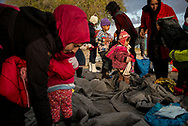 Moments after a dinghy landed on the coast of Lesvos carring about 40 migrants, many of them children. About 8500 migrants and refugees are living in hard condition on the island of Lesvos, many of them outside the organized camp. Mitilene, Greece. December 12th 2017.