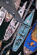 Usa, Newport, RI- Mast-top view of Intrepid, classic old America's Cup 12 meter docked within a yacht transport vessel preparing to ship to England for the races in Cowes..