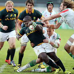PADUA, ITALY - NOVEMBER 22: Trevor Nyakane of South Africa is tackled by Sergio Parisse (captain) of Italy during the Castle Lager Outgoing Tour match between Italy and South African at Stadio Euganeo on November 22, 2014 in Padua, Italy. (Photo by Steve Haag/Gallo Images)