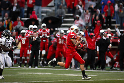 25 September 2010: Ben Ericksen sprints away from Chris Douglas and down the sidelines to almost score a goal returning the opening kickoff. The Missouri State Bears lost to the Illinois State Redbirds 44-41 in double overtime, meeting at Hancock Stadium on the campus of Illinois State University in Normal Illinois.