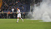 Italy goalkeeper runs away as Serbian fans throw flares on the pitch during the UEFA EURO 2010 Group C qualifying match between Italy and Serbia was suspended at Luigi Ferraris Stadium on October 12, 2010 in Genoa, Italy.