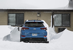 April 14, 2018 - The vibrant blue paint of a guest's late model Hyundai Tucson provides a pop of color to the surrounding monochromatic white monster snowdrifts surrounding it in the parking lot of the Super 8 Motel in Valentine, Nebr. during a ferocious blizzard on April 14, 2018. A historic late season blizzard struck the Northern Plains Friday and Saturday, with storm total accumulations ranging from 1-2 feet and sustained winds of 35-45 mph with gusts in excess of 60 mph, closing dozens of roads including Interstate 80 and leading Nebraska Governor Pete Ricketts to declare a state of emergency. ..Photographer/byline/author: Mark 'Storm' Farnik ..City: Valentine  ..State: Nebraska ..Country:  U.S. ..Category (CAT Code): NEW..Date: 20180414 (Credit Image: © Mark 'Storm' Farnik via ZUMA Wire)