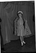 09/03/1964<br /> 03/09/1964<br /> 09 March 1964<br /> McBirney's Fashion show at McBirney's, Aston Quay, Dublin. Image shows Barbara wearing a pink coat and dress from the collection.