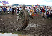 A festival goer makes the most of the mud during day one of Reading Festival on August 27, 2010 in Reading, England.  (Photo by Simone Joyner)