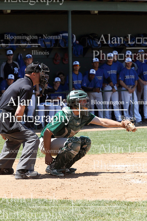 11 May 2013:  A.J. Nathan in front of umpire Chris Viverito during an NCAA division 3 College Conference of Illinois and Wisconsin (CCIW) Pay in Baseball game during the Conference Championship series between the North Park Vikings and the Illinois Wesleyan Titans at Jack Horenberger Stadium, Bloomington IL
