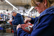 Barb Harnishfeger inspects an official game ball for the NFL football Super Bowl XLIX before it is shipped out at the Wilson Sporting Goods Co. in Ada, Ohio, Tuesday, Jan. 20, 2015. The New England Patriots will play the Seattle Seahawks in the Super Bowl on Feb. 1 in Glendale, Arizona. (AP Photo/Rick Osentoski)