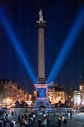 © Licensed to London News Pictures. 09/05/2015. London, UK. As part of the capital's VE Day 70th anniversary celebrations, Trafalgar Square is lit up with V-shaped floodlights, in the same way as they were in 1945. Photo credit : Stephen Chung/LNP